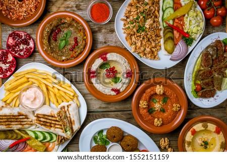 assorted Turkish dishes, hummus, muhamara, mutabal, falafel, shawarma Stock photo ©