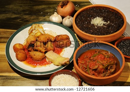 Assorted typical cuban dishes over wooded table