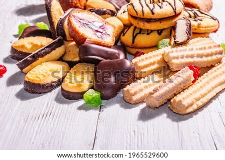 Assorted various cookies and cupcakes. Trendy hard light, dark shadow. White wooden boards background, copy space Stockfoto ©