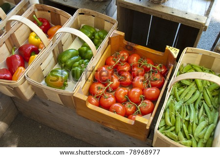 Assorted vegetables in baskets at a farmers market
