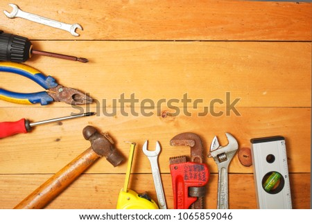 Assorted work and home tools.Wooden background and copy space #1065859046