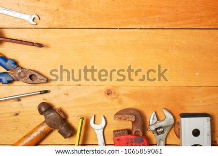 Assorted work and home tools.Wooden background and copy space #1065859061