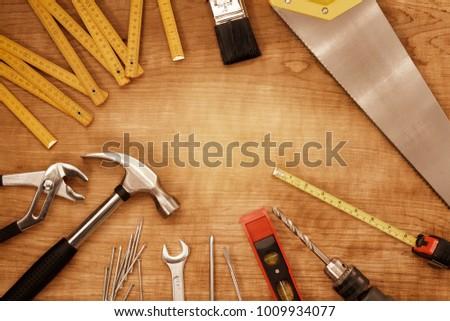 Assorted work tools on wood #1009934077