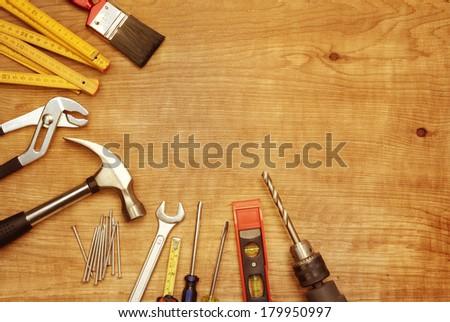Assorted work tools on wood #179950997