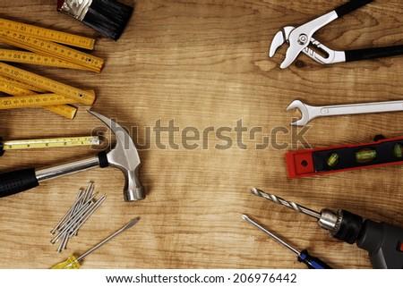 Assorted work tools on wood #206976442