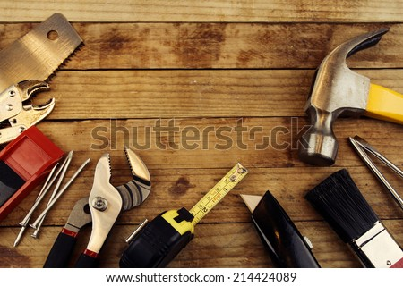 Assorted work tools on wood #214424089