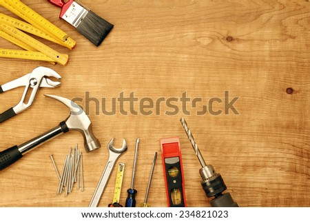 Assorted work tools on wood #234821023