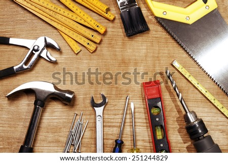 Assorted work tools on wood #251244829