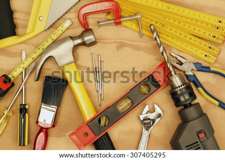 Assorted work tools on wood #307405295
