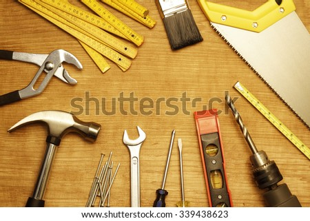 Assorted work tools on wood #339438623