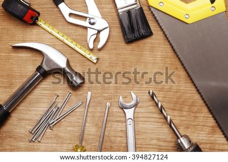 Assorted work tools on wood #394827124
