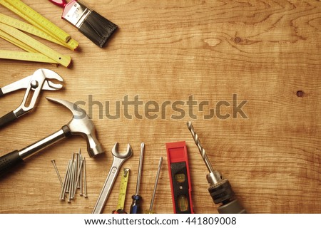 Assorted work tools on wood #441809008