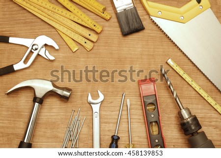 Assorted work tools on wood #458139853