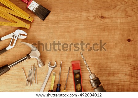 Assorted work tools on wood #492004012