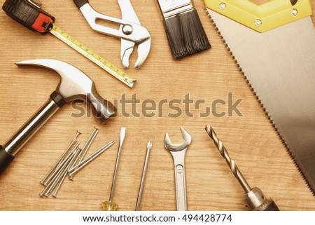 Assorted work tools on wood #494428774