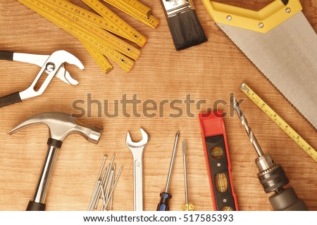 Assorted work tools on wood #517585393
