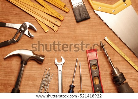 Assorted work tools on wood #521418922