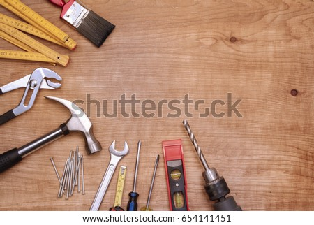 Assorted work tools on wood #654141451