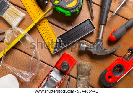 Assorted work tools on wood background #654485941