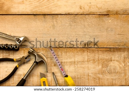 Assorted work tools on wooden background #258274019