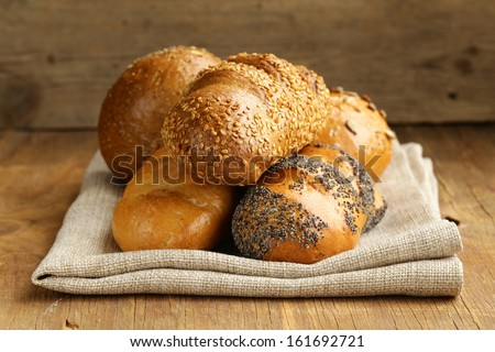 assortment bread (rye, white long loaf, whole-grain cereal bun)