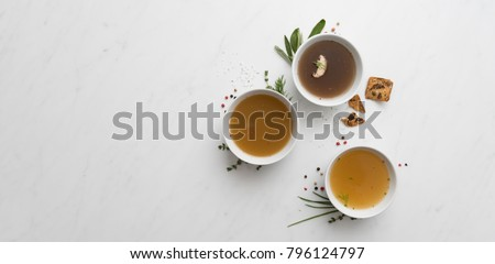 Assortment ob Broth in Small Bowls