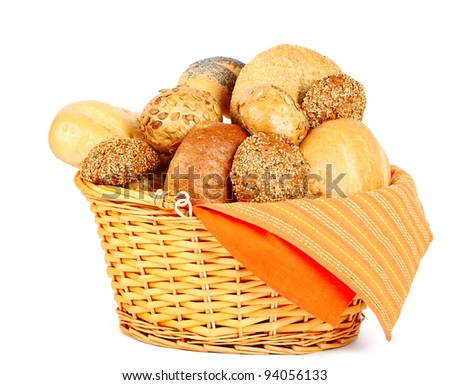 Assortment of baked bread in a basket on white background