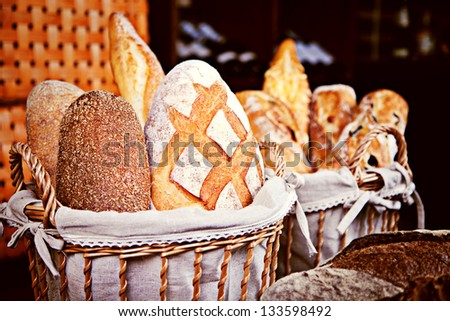 Assortment of baked bread in baskets