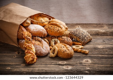Assortment of baked goods on old wooden table