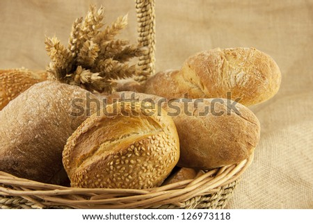 assortment of bread and pastries in a basket #126973118