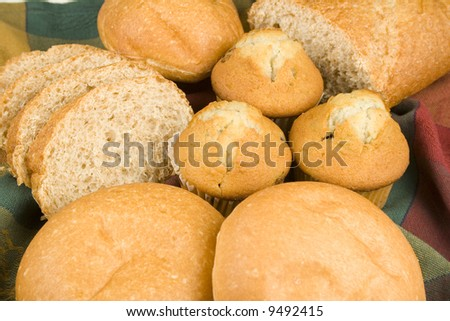 assortment of breads on nice table cloth