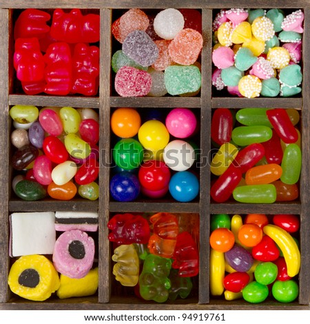 assortment of candy for a background, nine types in a printers box.