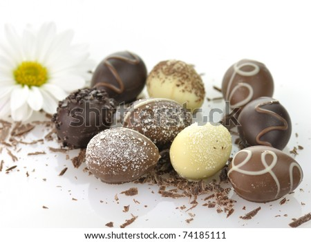 assortment of chocolate eggs on white background
