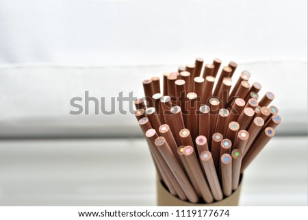 Assortment of colored pencils/Colored Drawing Pencils/Colored drawing pencils in a variety of colors,close up pencil piles,pencil nibs in pencil cylinder.