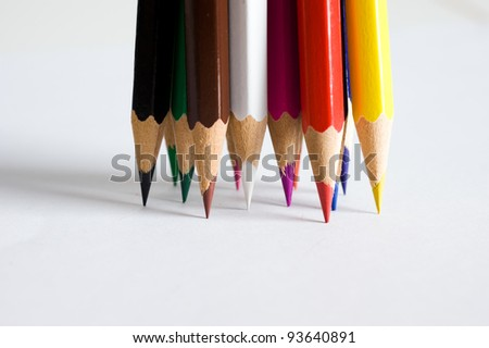 Assortment of colored pencils on white paper