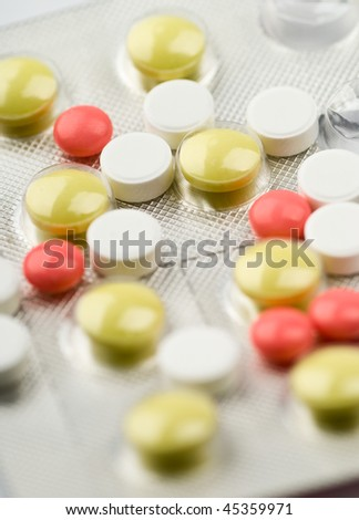 Assortment of colored pills. Shallow depth of field.