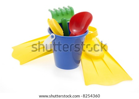 Assortment of colorful beach toys on a white background.