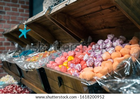 Assortment of colorful delicious marmalade jelly candies for sale on counter of shop, grocery, market, cafe. Dessert, sweet food and confectionery concept
