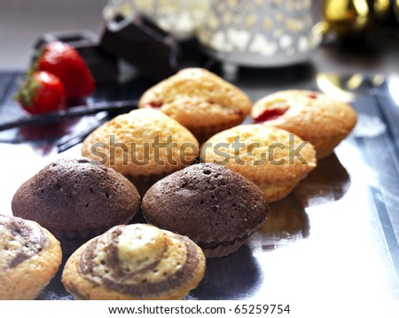 assortment of cupcakes with a christmas decoration
