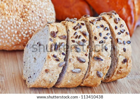 assortment of cut baked bread  with different seeds