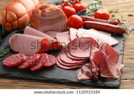 Assortment of delicious deli meats on slate plate Stok fotoğraf ©