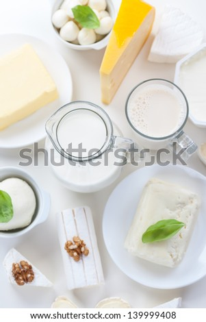 Assortment of different dairy products on white background