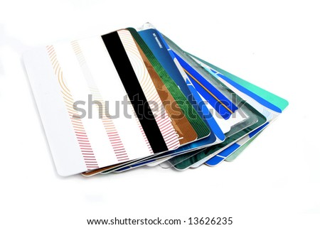 assortment of different plastic cards used in everyday life, like banking, shopping and other personal identification