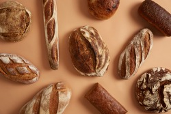 Assortment of different tasty baked bread for eating. Close up photography, great design for any purposes. Organic nutrition concept. Bakery and food. Nourishing product with appetizing crust