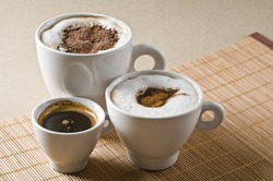 Assortment of different tasty hot coffee drinks - espresso, cappuccino, mochaccino
