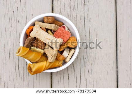 Assortment of dog treats in white bowl