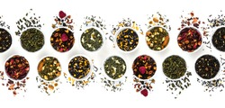 Assortment of dry tea in bowls isolated on white background. Flat lay pattern. Red, fruit, green, black and herbal leaves dried fresh dessert beverage layout. Top view concept. Healthy, organic drink