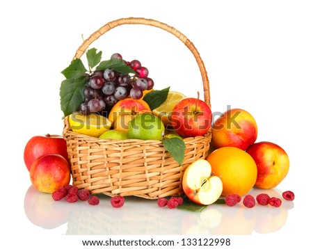 Assortment of exotic fruits in basket, isolated on white