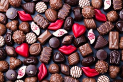Assortment of fine chocolate candies, white, dark and milk chocolate. Sweets background. Copy space. Top view.
