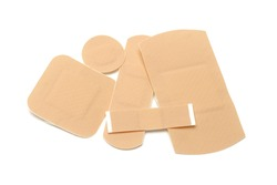 Assortment of first aid plasters on white background
